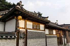 picture of dong  - Traditional korean house front gate with the sunset light - JPG