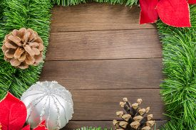 picture of poinsettia  - Christmas Decoration With Silver Bauble And Poinsettia On Wooden Background - JPG