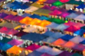 image of roof-light  - Blurred bokeh lights of aerial view multiple colors flea market roof top - JPG