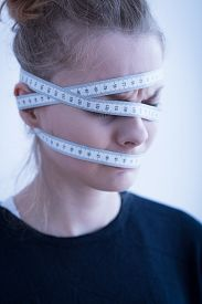 foto of anorexic  - Close up of an anorexic female with tape - JPG