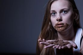 pic of bulimic  - Photo of sick skinny girl with dirty mouth from chocolate - JPG