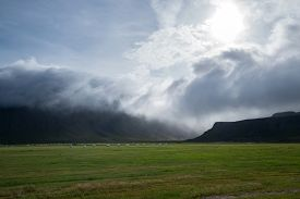 pic of iceland farm  - Cloudy day over the farms in Iceland - JPG