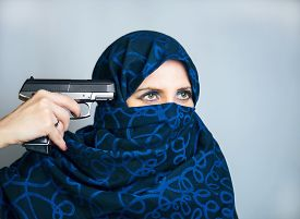 foto of yashmak  - Woman suicide paranzhe shoots a gun photo studio - JPG