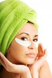 stock photo of gels  - Spa serene woman with gel eye mask and hands on chin - JPG