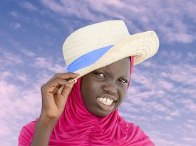 stock photo of ten years old  - Muslim girl wearing a straw hat at dawn - JPG