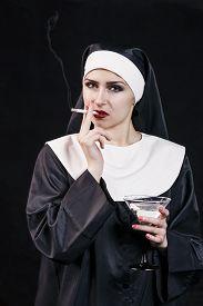 stock photo of lewd  - Smoking young nun - JPG