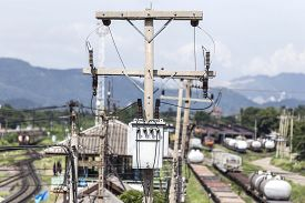 stock photo of transformer  - Two phase transformer on electrical post at train maintenance station - JPG