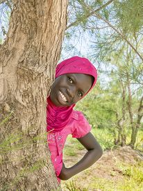 stock photo of ten years old  - Afro girl playing hide - JPG