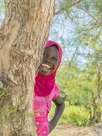 foto of ten years old  - Afro girl playing hide - JPG