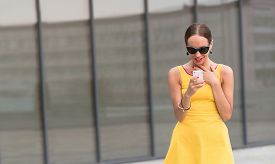 image of little girls photo-models  - Portrait of fashion girl walking in the city centre - JPG