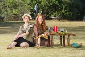 foto of sabbatical  - Two serious pagan females sitting at altar with pentagram - JPG