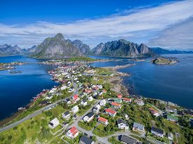 stock photo of reining  - Picturesque fishing town Reine on Lofoten islands in Norway seen from air - JPG