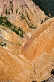 pic of ravines  - Deep ravine with geological clay and sandstone layers - JPG