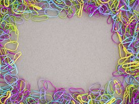 stock photo of rubber band  - Colorful rubber band on brown crate paper background - JPG
