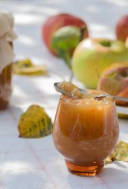 image of indian apple  - Autumn apple jam with spoon and leaves - JPG