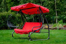 foto of canopy  - Canopy swing or garden swing in a lawn - JPG