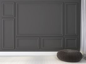 picture of ottoman  - Stylish knitted ottoman near gray wall with frames - JPG