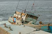 stock photo of swales  - A boat waiting flood tide - JPG