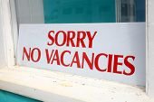 Sorry No Vacancies Sign In A Guesthouse Window.