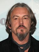 PASADENA, CA - JAN 11:  Tommy Flanagan arrives at the FOX All-Star Party on January 11, 2011 in Pasa