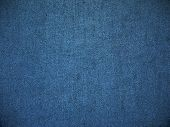 Texture denim. Cloth rough, worn, with small defects, slight darkening at the corners. Realistic fab