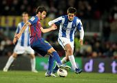 BARCELONA - FEB 4: Cesc Fabregas (L) of Real Sociedad vies with Markel Bergara(R) of Real Sociedad d