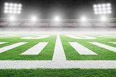 Close Up Of American Football Stadium Field With Yard Line Markings And Spotlight With Blurred Backg poster
