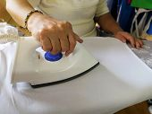 Woman Ironing Clothes On Ironing Board. Woman Ironing Clothes.concept Of Ironing. poster