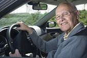 image of senior-citizen  - Happy senior man out for a drive - JPG