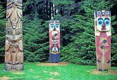 stock photo of totem pole  - Totem poles in a historical park in Sitka Alaska - JPG