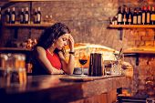 Woman Having Headache While Waiting For Man In Bar poster