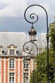 Ornate Lampposts At Places Du Vosages In Paris