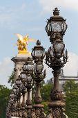 Ornate Lampposts On Alexander III Bridge In Paris