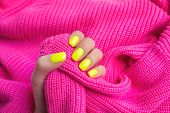 Stylish Trendy Female Manicure. Neon Yellow Nails On Plastic Pink Background. Nail Polish. Art Manic poster