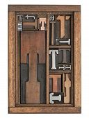 letter T abstract - vintage letterpress printing blocks of different size and style in a wooden box with dividers