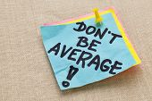 Motivational concept - Do not be average exclamation  - handwriting on a blue sticky note against ca