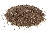 a heap of organic chia seeds rich in omega-3 fatty acids, side view on white,