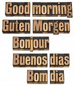 Good morning in five languages - English, German, French, Spanish and Portuguese - a collage of isol