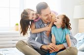 Happy loving family. Daddy and his daughters children girls playing together. Fathers day concept. poster