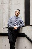 Hispanic Businessman - Leaning On Stair Rail