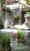 Beautiful cascading waterfall fountain in garden