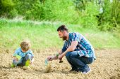 Eco Living. Happy Earth Day. Family Tree. Father And Son Planting Flowers In Ground. New Life. Soils poster