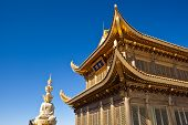 stock photo of emei  - The golden palace and Statue of samantabhadra on Golden Summit in Mount Emei - JPG