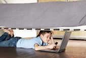 pic of mobile-phone  - Child with laptop and phone under the bed - JPG