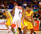 KUALA LUMPUR - FEBRUARY 19: Singapore Slingers' M. Pathman shields the ball from Dragons' Tiras Wade