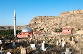 cemetery, mosque and the village of Yaprakhisar near the Ihlara valley in Cappadocia - Turkey