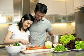 stock photo of happy family  - Asian Family spending time together in the kitchen - JPG