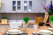 Kitchen Interior With Gray Facade. Serving The Kitchen Table. Flowers In The Kitchen; poster