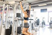 Determined Woman In Sports Clothing Doing Strength Training Exercise For Long-term Health Benefits poster
