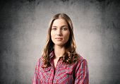 Young Woman Having Serious And Calm Face. Caucasian Female Student Has Confident Facial Expression.  poster